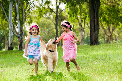Girls_with_dog_shutterstock_96524833_cropped
