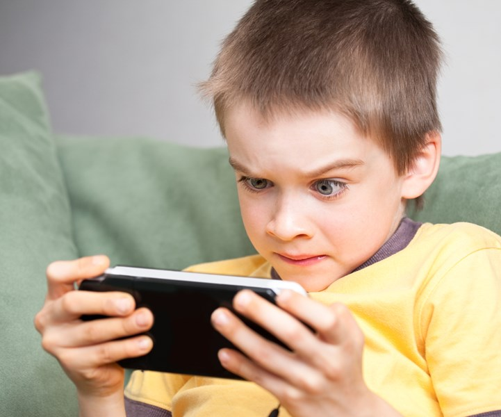 boy_looking_at_phone_screenshutterstock_51928348