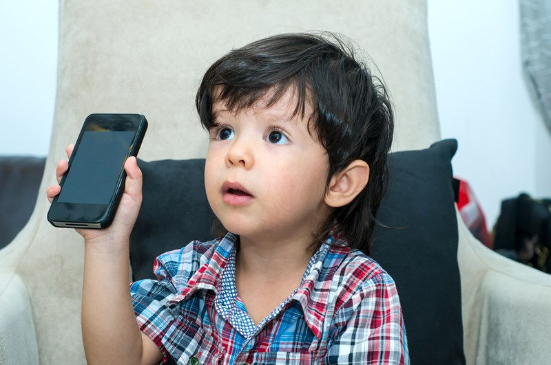 young_boy_cell_phone_shutterstock_148606004
